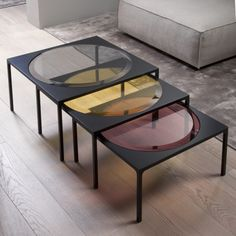 Rulli / Coffee table with 12mm bevelled (3cm) glass top, available stratified glass in the colours smoke, amber, amethyst or extralight transparent glass. White or black lacquered aluminium and wooden structure.
