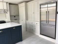 A truly stunning example of one of our handmade kitchens, painted in Off white and dark grey, with quartz worktops and an undermounted sink