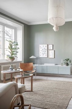 I'm loving the wall colors in this light Swedish home with turn of the century details. The living room has this dusty green wall color, which is matched by the Ikea Besta cabinet on the wall (nice touch I think). Sage Living Room, Accent Walls In Living Room, Room Decor Bedroom, Interior Design Living Room, Home And Living, Living Room Designs, Living Room Decor, Green Wall Color, Green Accent Walls