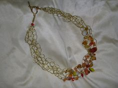 Gold Wire crocheted choker with glass beads.