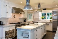 Ready to cook up a storm: The 15,000 sq ft home has a gourmet kitchen fitted out with high...