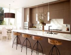 exquisite modern kitchen in white and brown with sleek pendant lights above the kitchen island 55 Lovely Hanging Pendant Lights For Your Kitchen Island interior design 2