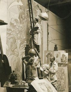 Dean Cornwell (below) and Theodore Lukits (on ladder), working on the murals for…