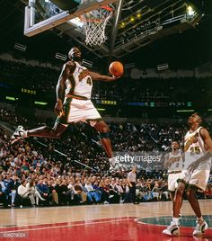 Shawn Kemp Pictures and Photos. Shawn Kemp of the Seattle Supersonics dunks  during a game circa 1996 at Key Arena in Seattle Washington NOTE TO USER ... c569718c1