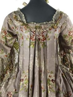 """1767-Sacque-""""This term seems to have first been used in the 1750s and was applied to gowns with a loose back. The fabric was set in folds below the shoulders from which it fell to the ground where it ended in a short train. The sack developed from an earlier gown worn for informal occasions, called in France a 'robe volante' or 'flying dress', presumably because of the shape it would have been produced when its wearer was moving forward."""""""