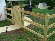dog fence 3 wood, 3 board, paddock fence w/ mesh backyard desi. Diy Backyard Fence, Diy Garden Fence, Backyard Landscaping, Patio, Fenced In Backyard Ideas, Cheap Garden Fencing, Outdoor Fencing, Yard Fencing, Mesh Fencing