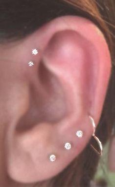 Crystal Ear Piercings, Tragus Earring, Cartilage Studs, Triple Forward Helix Studs Internally Threaded Avaliable at Cool Ear Piercings, Types Of Ear Piercings, Ear Piercings Tragus, Cartilage Earrings, Neck Piercing, Unique Body Piercings, Tragus Stud, Barbell Piercing, Ear Piercings