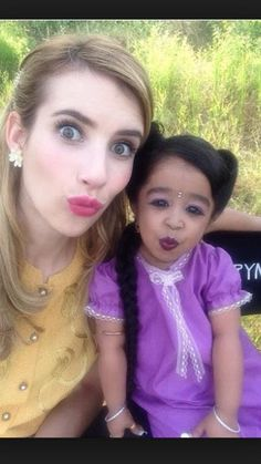 Freak Show. Jyoti Amge as Ma Petite and Emma Roberts as the fortune teller Maggie Esmerelda.