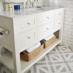 Tulum II encaustic floor tile from the Cement Tile Shop sets the tone in this fresh-feeling bathroom.