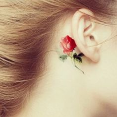 This behind-the-ear rose is adorable.