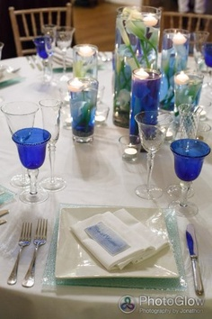 (c) Photoglow water theme wedding table blue coloured glass from Whitehouse Event Crockery - shades of blue water in vases with floating candles @Maria Canavello Mrasek Willcox ombre tablecloth provided by @Allison House! of Bunting