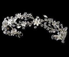 Beautifully detailed hand wire wrapped headpiece. Created with rhodium plated components, sparkly rhinestones, silver flowers and finished with