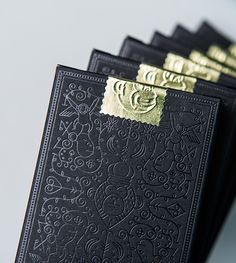 Black foil on black paper | MailChimp Playing Cards by Fuzzco