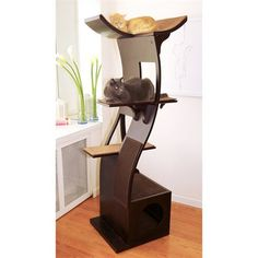 This Lotus Cat Tower is a modern piece of cat furniture that is sure to keep your cat happy while looking good in your home.