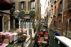 Gondola on Canal by Cafe Venice, Italy - Masterfile - Rights-Managed, Artist: Damir Frkovic, Code: Outdoor Cafe, Outdoor Areas, Z Cafe, Courtyard Cafe, Sidewalk Cafe, Italian Villa, Cafe Restaurant, Hotel Spa, Adventure Awaits