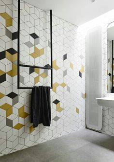 Add a pop of colour to your bathroom tile design with geometric tiles Yellow Bathroom Decor, Modern Bathroom Tile, Yellow Bathrooms, Bathroom Tile Designs, Bathroom Interior, Bathroom Tiling, Bathroom Ideas, Bathroom Cabinets, Funky Bathroom