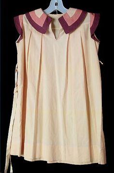Dress, girl's, yellow cotton, brown and orange cotton trim, c. 1937