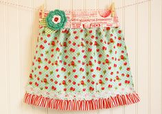 StrawberryApron  http://www.craftinessisnotoptional.com/2010/09/childs-gathered-apron-tutorial.html