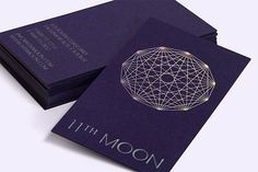 Keeping in mind the clothing boutique's celestial name and the owners' love of astronomy, RoAndCo devised these wallet-sized wonders for 11th Moon. Printed on thick purple stock, the foil-stamping technique gives them an iridescent look.