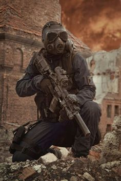 Nuclear post apocalypse survivor by zabelin on PhotoDune. Sole survivor in tatters and gas mask on the ruins of the destroyed city Apocalypse Survivor, Apocalypse Art, Military Gear, Military Weapons, Mad Max, Airsoft, Fallout, Post Apocalyptic Art, Military Special Forces