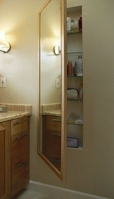 Master Bath - Use space between studs with a hinged mirror in front for extra storage (cleaning supplies, excess bath/hair products, medicine cabinet, etc)