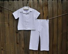 Boy white linen shirt and natural linen drawstring pants, great for boys of all ages. Ideal for outdoor weddings, special occasions, family photos or just a trip to the beach. This shirt and pant set is made of linen blend fabric for a comfortable and WASHABLE wear. Pants are flat front with drawstring. Shirt is short sleeved with a OPEN collar and buttons down the front. Flat hemmed bottom of a casual look untucked over pants or shorts. This shirt has a roomy fit and is designed to have a…