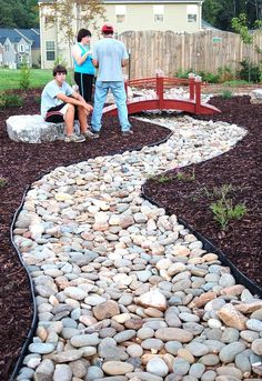A Simple Guide To Diy Creek Bed - Trendy DIY Ideas.  stage One before the planting seeds and boulders.