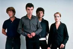 The pop band Talking Heads pose for a portrait before a white backdrop. Left to right: drummer Chris Franz; keyboardist Jerry Harrison and bassist Tina Weymouth World Music, Music Is Life, Dangerous Minds, Amazing Songs, The New Wave, Latest Albums, Alternative Music, Pop Bands, Latest Music