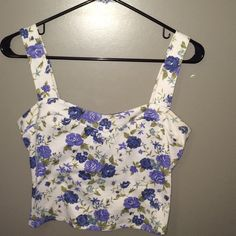 Floral Print Crop Top Blue floral crop top, back has 3 bow cut outs Charlotte Russe Tops Crop Tops