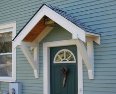 "This exterior door is protected by a classic ""roofette."""