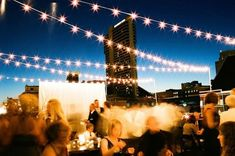 Romantic night time rooftop wedding  Photo Source: style me pretty #rooftopweddings #uniqueweddingvenues #reception