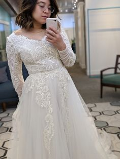 modest wedding dress with long lace sleeves from alta moda bridal