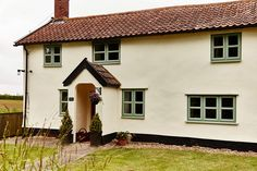 I like the idea of painting the foundation // uPVC casement window in dual Sage Green and White Knight Exterior Door Colors, White Exterior Houses, Cottage Exterior, House Paint Exterior, Green Front Doors, Front Doors With Windows, Green Windows, Casement Windows, House With Porch