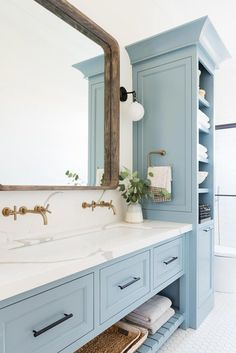 For the Home White and blue bathroom boasting a blue sink vanity with a white trough sink and marble Dream Bathrooms, Beautiful Bathrooms, Modern Bathroom, Master Bathrooms, Small Bathroom, Blue Bathrooms, Minimal Bathroom, Funky Bathroom, Beach House Bathroom