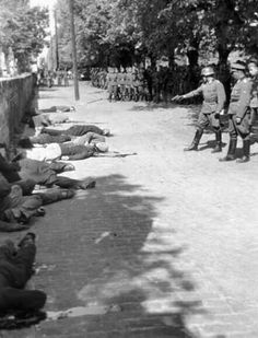 War crimes,WWII : A German army officer delivers finishing shots to executed hostages in Pancevo, Yugoslavia. Contrary to postwar claims, the regular German army was as deeply involved in the death of civilians as the SS and other murderer formations. World History, World War Ii, German Army, Military History, Old Photos, Iconic Photos, American History, Wwii, 1940s