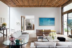 Designer Jenni Kayne's Los Angeles living room. The aerial photograph is by Richard Misrach, and the vintage chairs are from JF Chen.