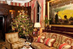 Enjoy Afternoon Tea by the Christmas tree in the Park Lounge at The Milestone Hotel in #London. The ideal break from shopping on Kensington High Street!  #Afternoon Tea #england