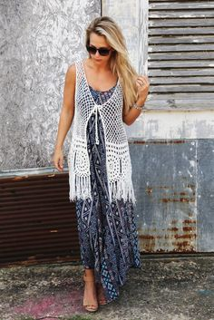 Cotton, acrylic blended. Ivory in color. Crochet + fringe vest. Front tie -- Tie it, or dont! Either way, it's precious! Perfect addition to any of this summers cutest finds! Model is wearing it here