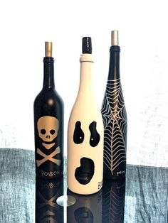 - This set of 3 hand painted wine bottles are completely one of a kind. A spider-web - potion, skull and crossbones - poison, and ghost - bottle of booze! - This set works wonders for your haunted man