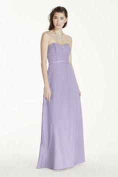The perfect blend of sophistication and romance, this strapless lace bodice and satin dress is a must-have for your bridesmaids! Strapless lace bodice with sweetheart neckline, accented at the waist with a delicate ribbon belt. Satin ball gown skirt provides a flattering silhouette and side slit provides a touch of drama! Lace 52% nylon/rayon, Skirt 100% polyester