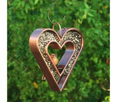 The heart within a heart design of this designer metal birdfeeder is the perfect gift for both you and your feathered loved ones. Plexiglass Panels, Copper Pots, Copper Kitchen, Bamboo Construction, Copper Decor, Wood Burning Fires, Stainless Steel Screws, Easy To Love, Backyard Birds