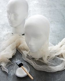 DIY cheesecloth ghost. the finished product is CREEPY!  I am definitely doing this for my yard on Halloween.  Will probably put the head on rebar though and stick in the ground.  No where to hang them.  :-(