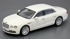 Bentley Flying Spur W12 in Glacier White 1:43 Scale diecast car. Great detail. Includes display case. Part # Kyosho 05561GW $80.10 http://www.kcautoacc.com/Bentley-Flying-Spur-V12-Glacier-White-143-Scale-Diecast-Kyosho-05561GW_p_14757.html