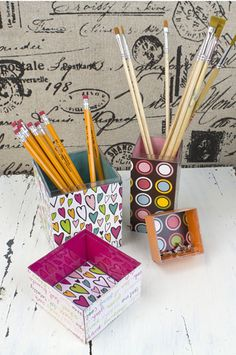 Plastic containers morph into an eye-catching set for office supplies with Americana DecouPage Glue.