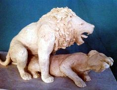 Clay sculpture lions mating