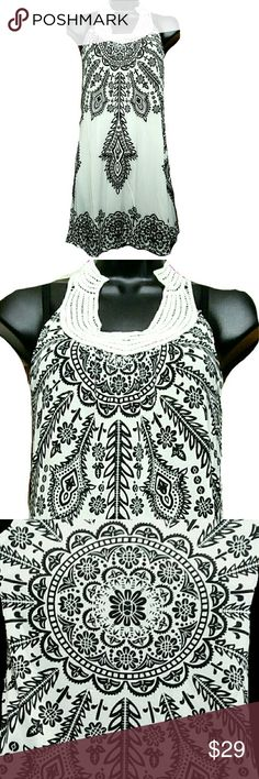 NWT The Rangoli Dress w/Lace Accent Collar Brand new with tags NWT The Rangoli Dress. Geometric floral print. Black & white. Unlined. It can be worn in various ways - a dress (slip not included), swimsuit cover, and a top. Approximate measurements are Bust 31 inches & Length 34 inches. Buttery soft stretchy fabric. This dress reminds me of an ethnic art called Rangoli. Exquisite! Dresses