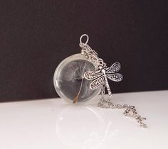 Dandelion necklace / Real dandelion jewelry / Dandelion seed / Christmas gift / Gift for her / Terrarium necklace / Make a wish necklace /Resin pendant Charm This necklace features a small (20mm) solid glass orb with one single real dandelion seeds inside. The length of the chain 24