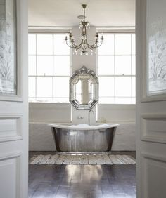 What a great bathroom- so simple and elegant. The tub is fantastic. I could see this as a fancy bathroom at a California ranch home.