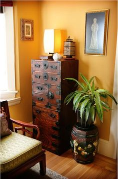Love the Japanese Tansu chest of drawers. Homey Transitional Bedroom by Claudia Juestel