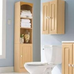 Tall Bathroom Cabinets bathroom cabinet with built-in laundry hamper | hgtvremodels